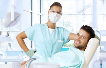 dentist and patient looking at the camera