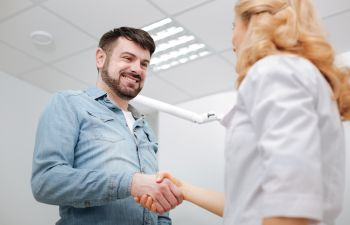 patient shaking hands with the dentist